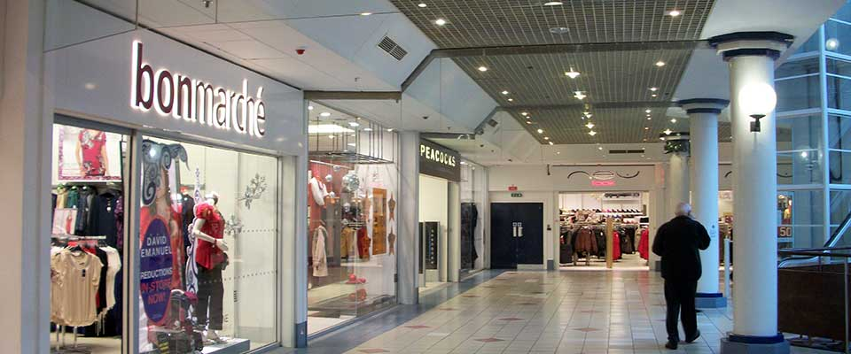 Man walking past Bon Marche on the Hagley Mall